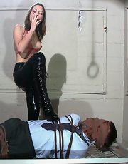 The very sexual Amber Rayne has her way with a wandering businessman in a suit. Tied down and mouth-packed, wild bill does not stand a chance with this fiery Dominatrix who sits on his face, strips him and painfully flicks his cock. A big orange strapon d
